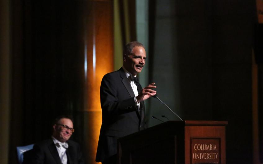 Photo of Eric Holder speaking at an event